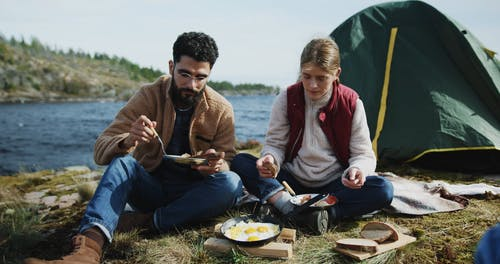 Couple Eating Fried Eggs and Bread