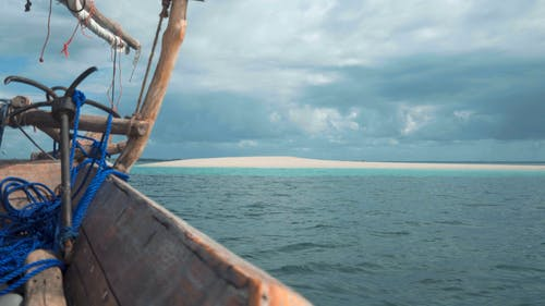 Wooden Fishing Boat Traveling on Sea