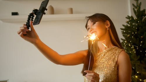 A Woman Taking A Selfie In A Party