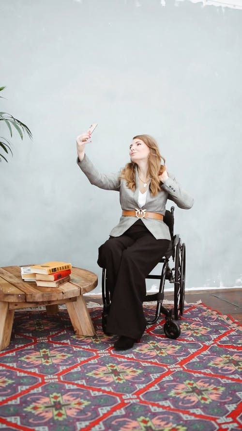 Woman Taking Selfie Using Her Smartphone