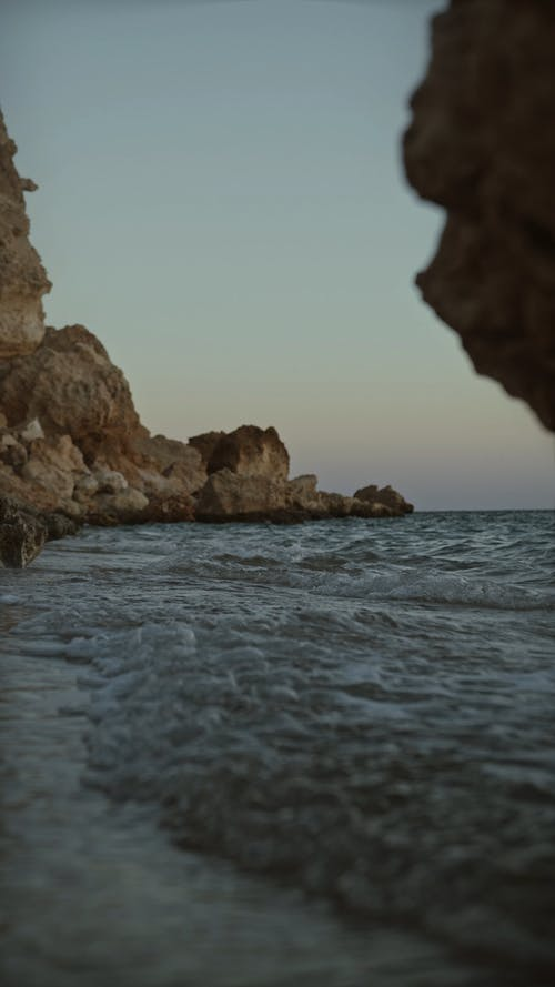 Sea Waves Crashing The Cliff Coast