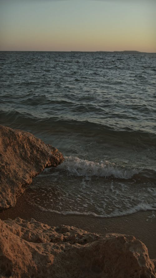 Sea Waves Causing Erosion On The Shore Rocks Formation