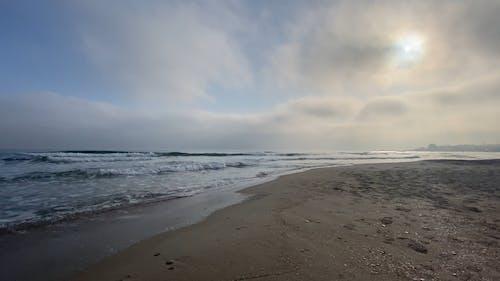 Beach Waves Crashing on the Sand