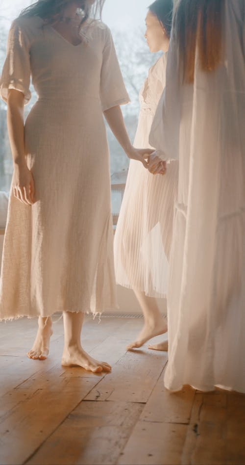 Three Women Walking In Circle