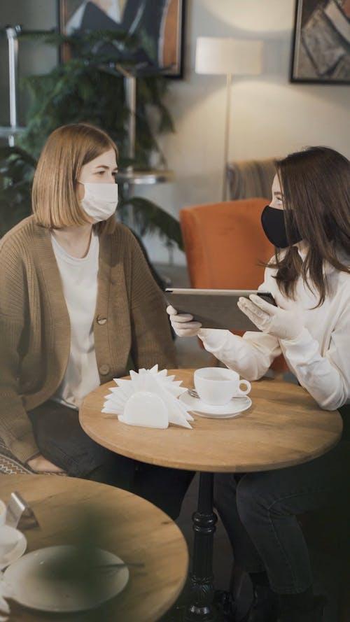 Women Wearing Face Mask Having Conversation