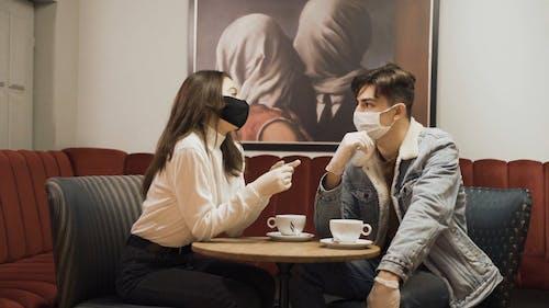 People Wearing Face Mask Talking