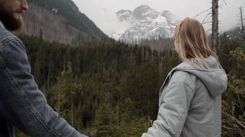 A Young Couple in the Mountains