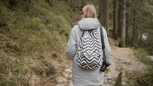 A Backpacker Woman Walking on Mountain Trek