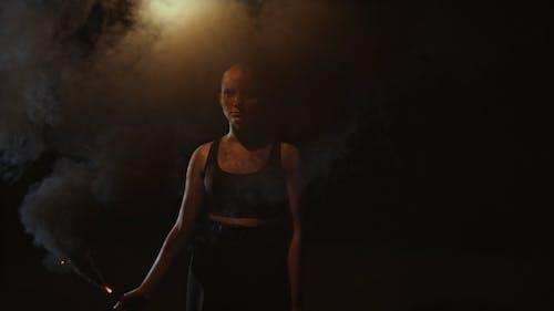 A Woman Holding a Smoke Flare