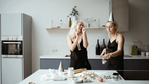 A Mother And Daughter Playful Moments While Baking