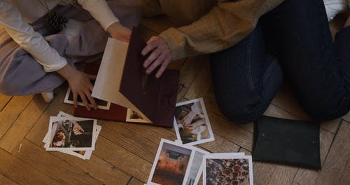 Family Looking at Pictures in Photo Album