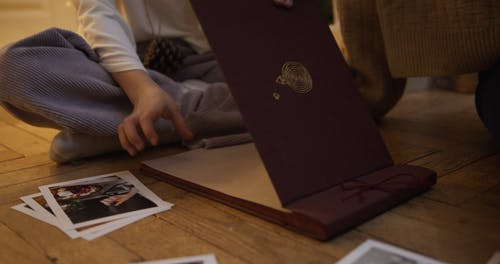 Family Placing Photgraphies on Photo Album