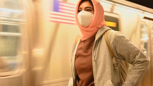 Woman With Hijab and Face Mask on a Train Station