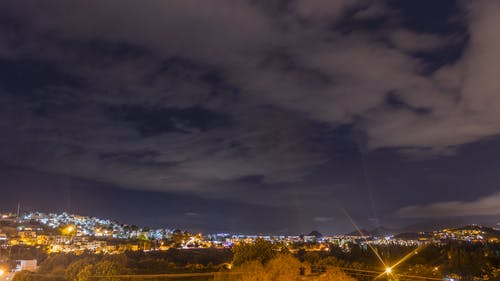 A Time-Lapse of a Cloudy Sky at Night