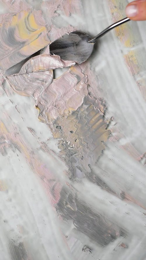Person Using a Painting Knife