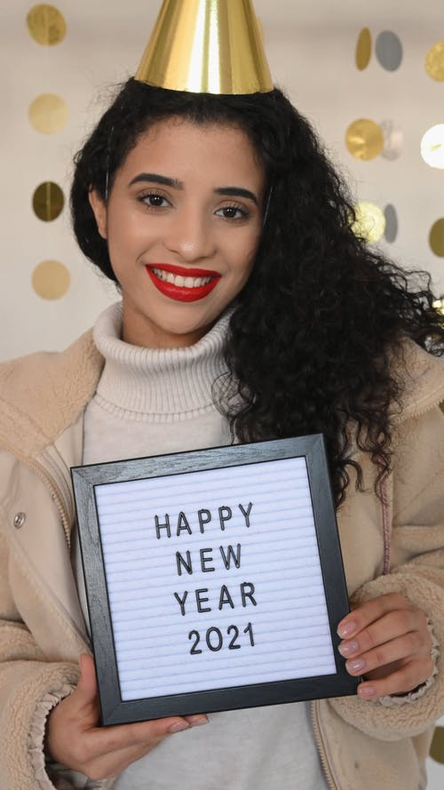Woman Holding New Year 2021 Frame