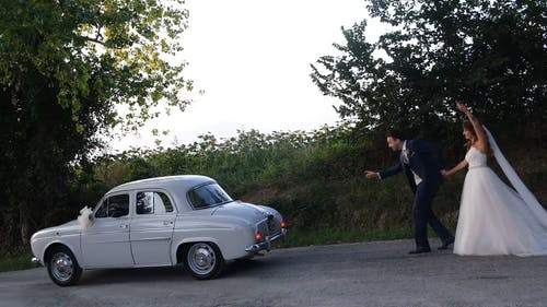 Couple Just Married Catching a Car
