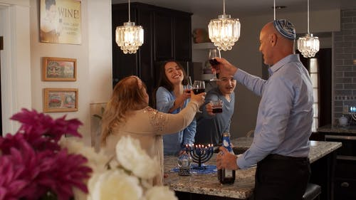 Family Making A Toast While Drinking Red Wine