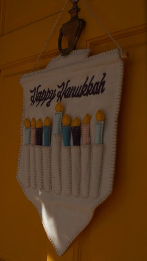 A Happy Hanukkah Display Hanging On Wall