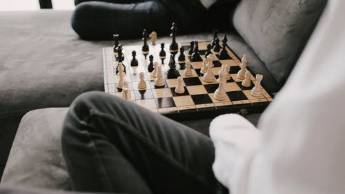 Two People Playing Chess in the Couch