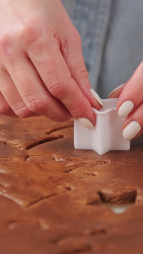 Woman Using Star Cookie Cutter