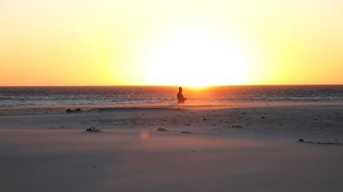 A Man Walking at the Beach