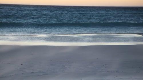 Sea Waves Hitting a Windy Seashore