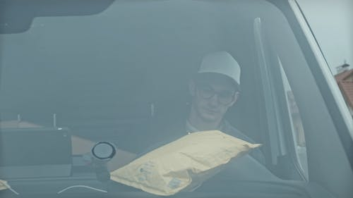 Delivery Man Checking Parcel Details and Going for Delivery