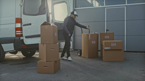 Adult Loading a Delivery Truck