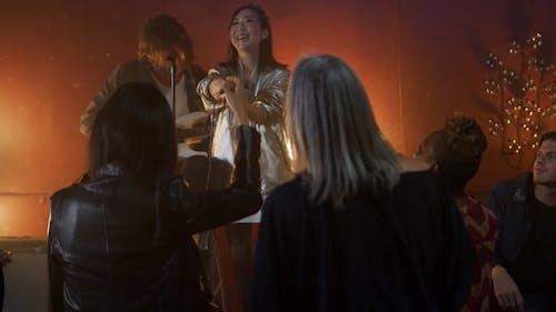 Woman Singing in a Club