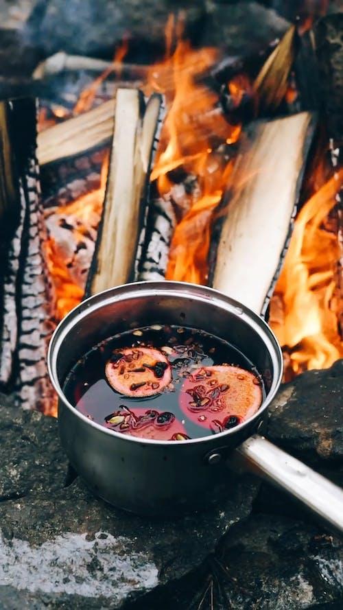 Orange Slices in Saucepan over Bonfire