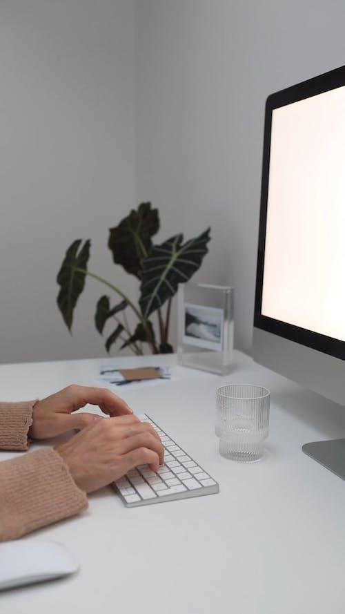 Woman Working on a Desktop