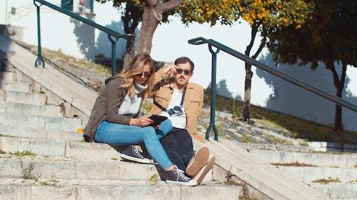 Beautiful Couple Sitting on Stairway