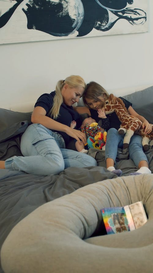 Mother with Her Daughters Playing
