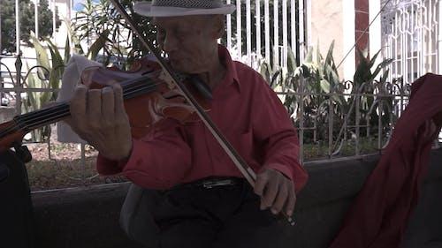Elderly Man Playing Violin