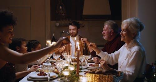 Lighting Sparklers Over Dinner
