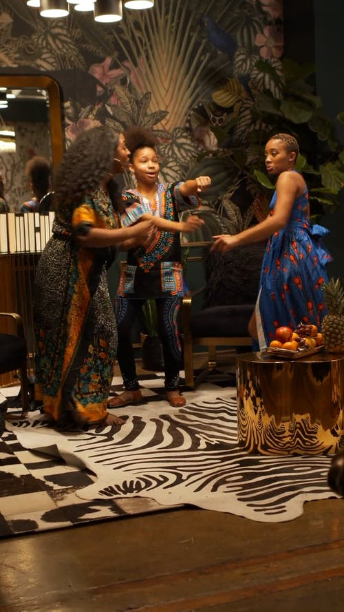 Women Dancing In Celebration Of African Holidays