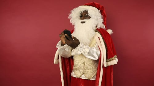 Santa Claus Is Using A Cellphone