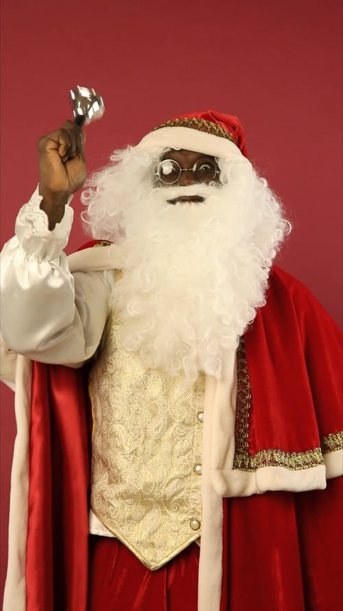 Santa Claus Is Ringing A Bell