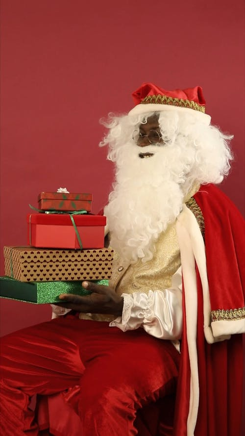 Santa Claus Holding Boxes Of Gift