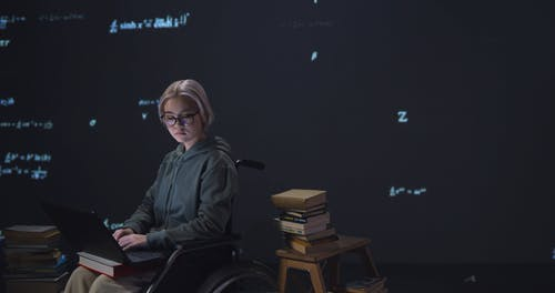 A Woman Sitting on a Wheelchair with Digital Background