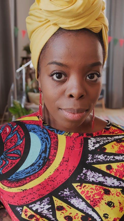Video Of Woman Wearing Yellow Headwrap