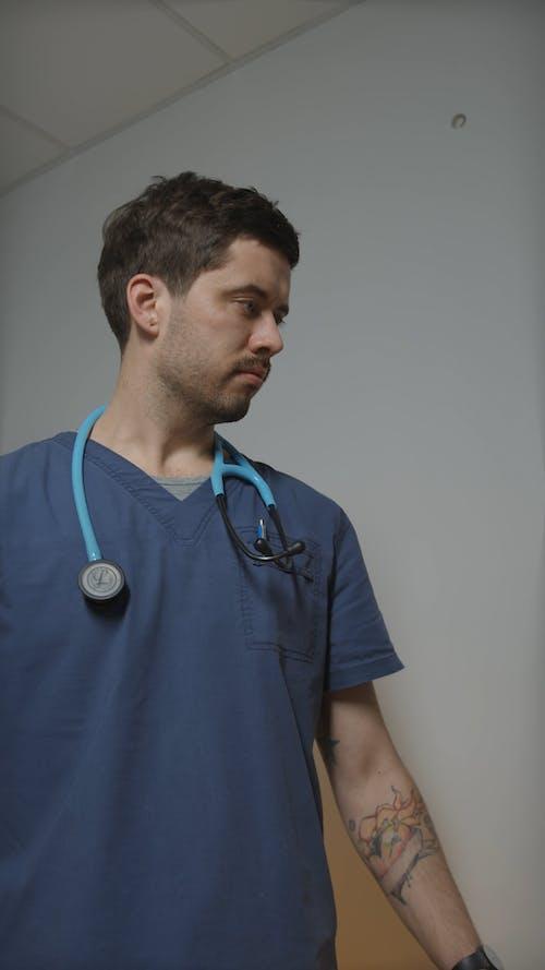 Man Operating Ultrasound Computer