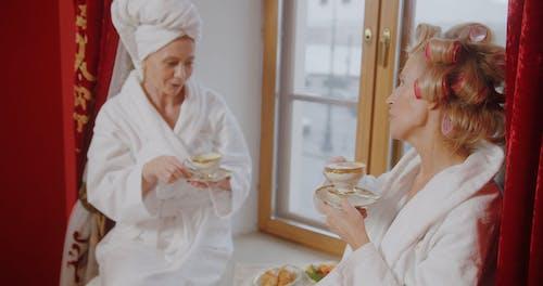 Elderly Women Having Coffee by at a Windowsill