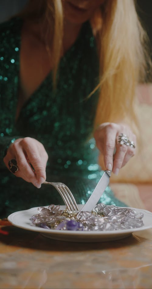 A Beautiful Woman Using Fork and Knife