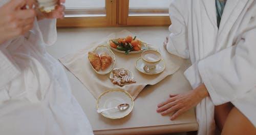 High Angle Shot of Elderly Women Eating Breakfast
