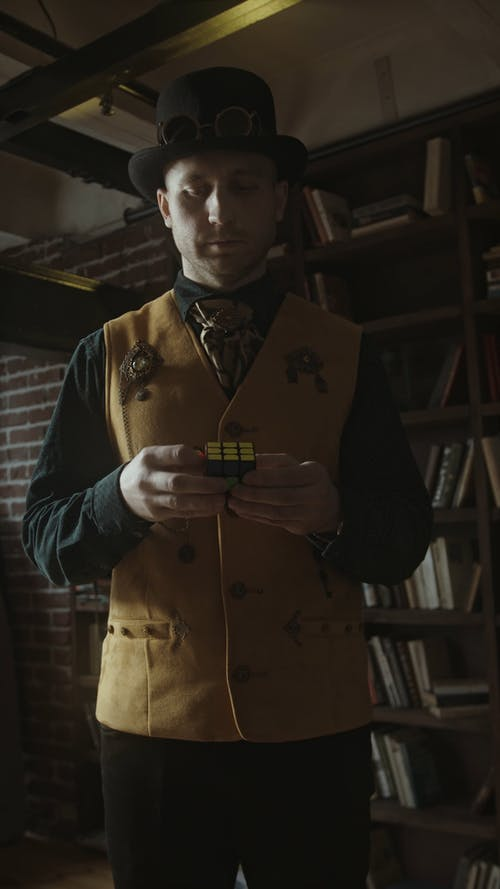A Person Playing with a Rubix Cube