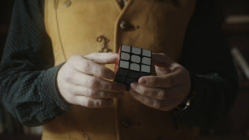 A Magician Playing a Rubix Cube