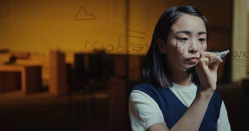 Woman Writing on Glass