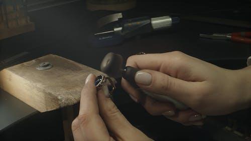 Woman Polishing a Jewelry Ring